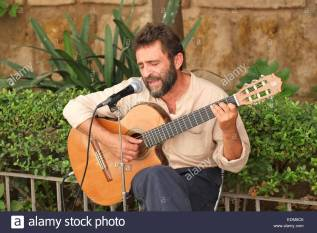 spanish-singer-and-guitar-player-performing-in-the-centre-of-seville-EDM6C6
